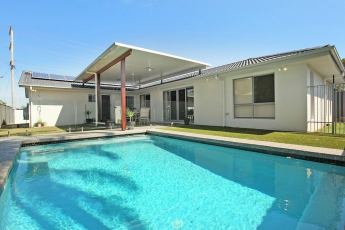 Photo: Palm 95 - Modern 4 BDRM Home with Pool